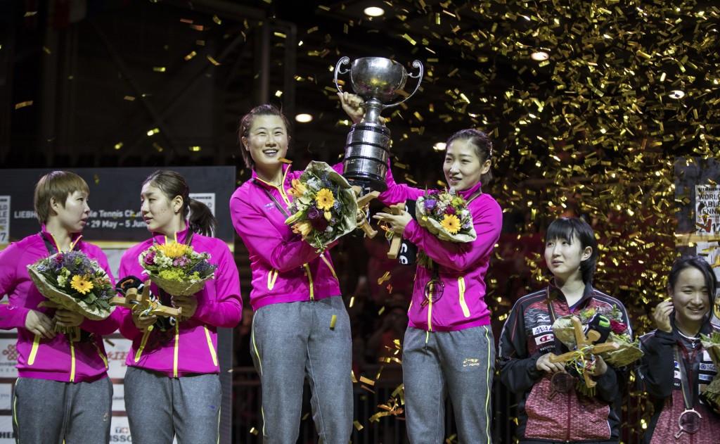 Ding Ning and Liu Shiwen lift aloft the women's doubles trophy ©Getty Images