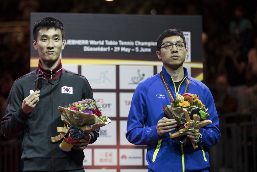 Lee Sang-su, left and Xin Xu took the two bronze medals in the men's singles ©Getty Images