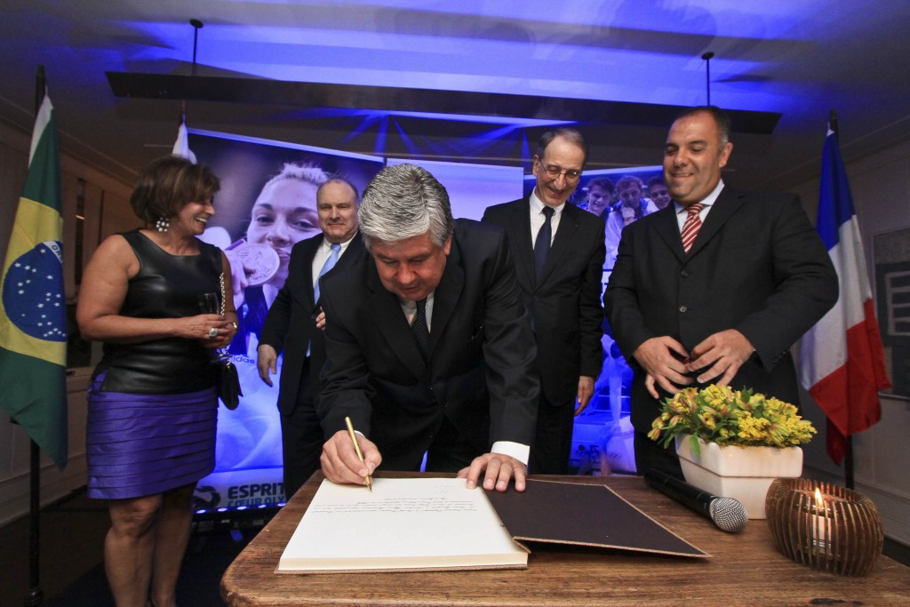 Denis Masseglia looks on as the contract is signed for France to have a hospitality house at the Sociedade Hípica Brasileira during Rio 2016