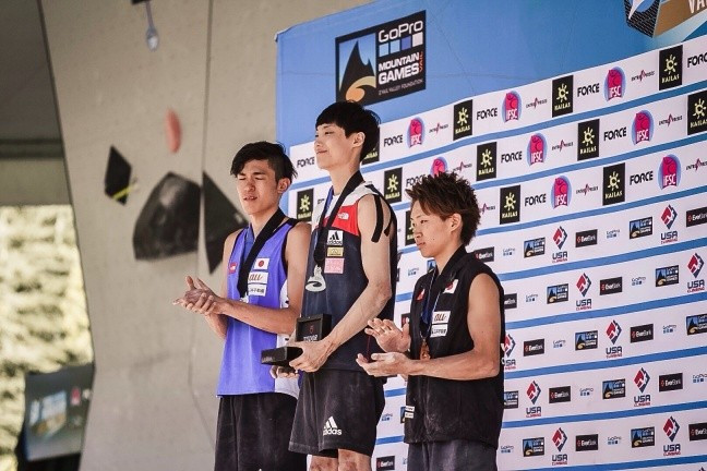 South Korea's Jongwon Chon, centre, moved closer to the top of the World Cup rankings with a win today ©IFSC