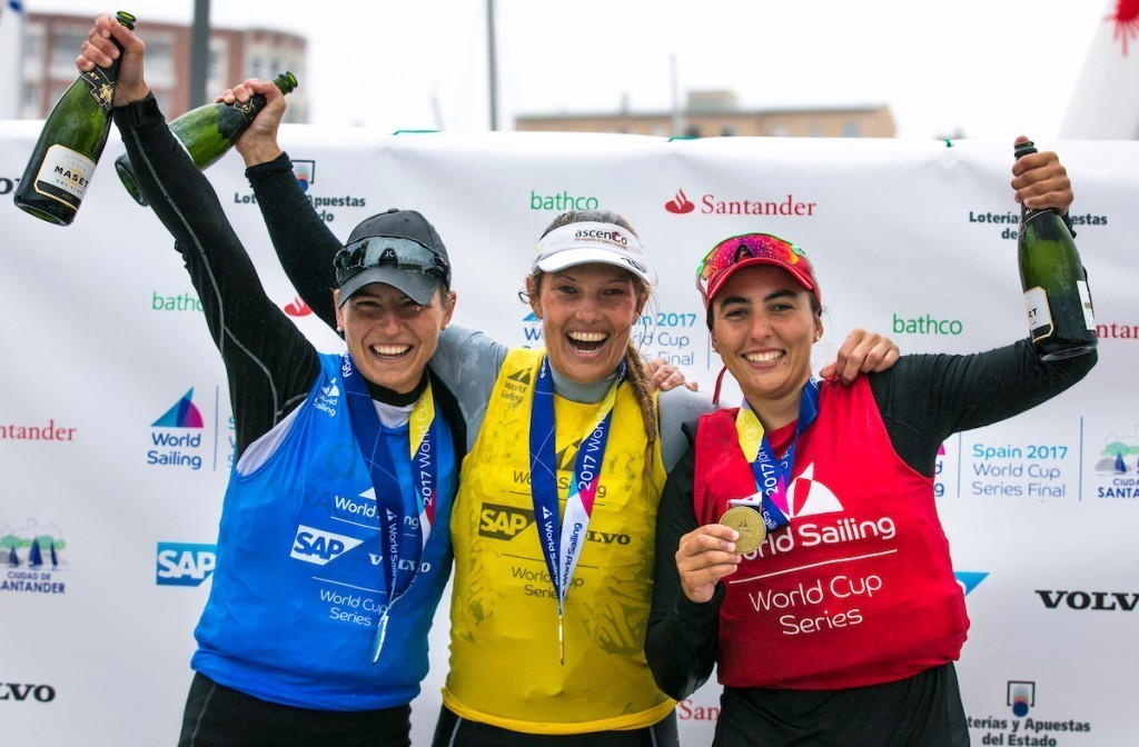 Evi van Acker, centre, eased to gold in the women's laser radial ©World Sailing