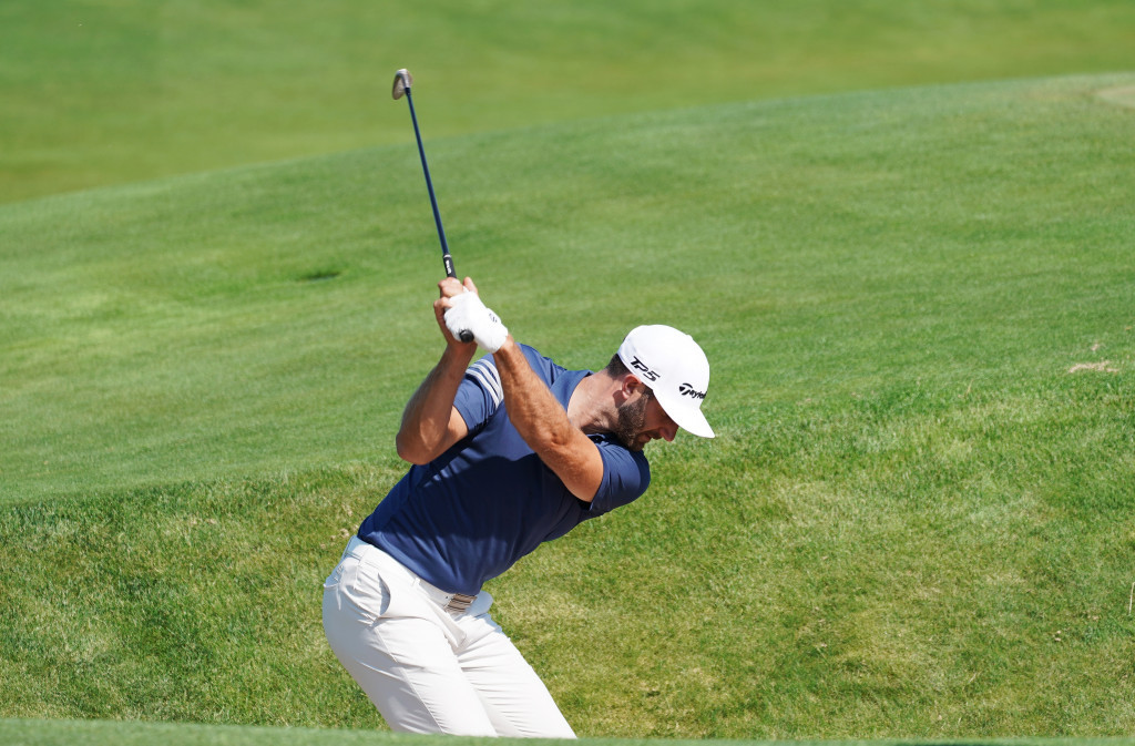 Dustin Johnson, seen here during a practice round at Erin Hills, will be looking to retain his US Open title ©Getty Images