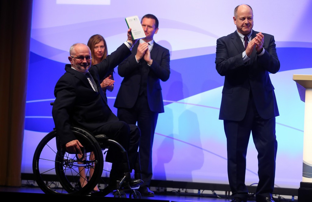 International Paralympic Committee President Sir Philip Craven shows off the special ceritificate presented to the governing body after winning the first-ever BP Courage Award in Berlin last year