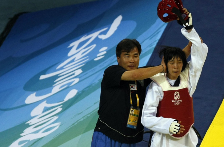 Hwang Kyung-seon, pictured with her coach after winning the Olympic middleweight taekwondo title in Beijing, was the only Korean gold medallist four years later in London ©Getty Images