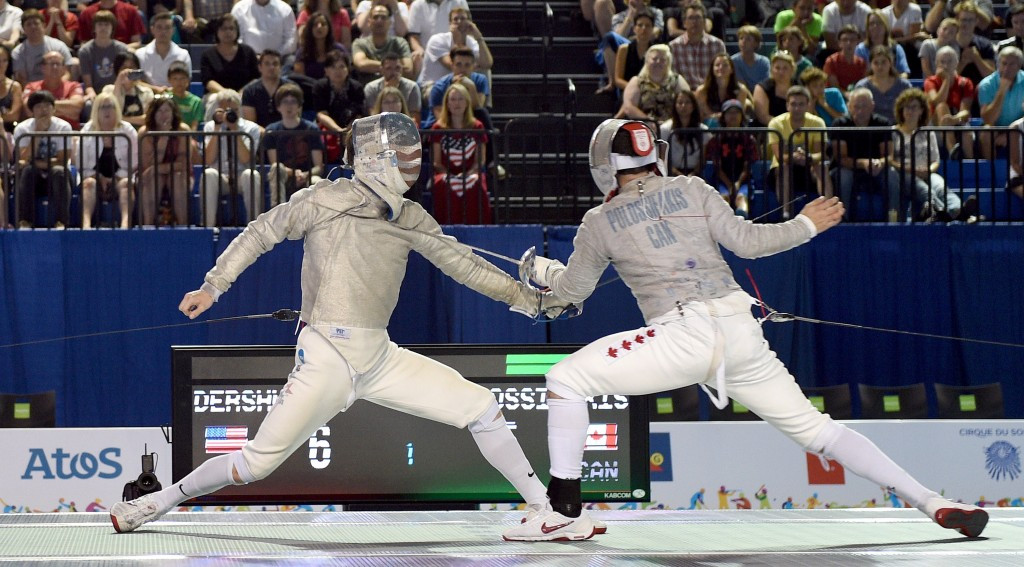 Gold medal winner Eli Dershwitz of the US (left) takes on Joseph Polossifakis of Canada during the men's sabre final ©Getty Images