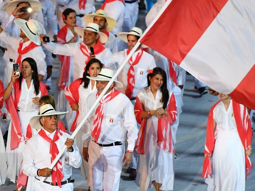 Former Peruvian Olympic Committee secretary general Francisco Boza Dibós, left, carrying his country's flag at Rio 2016, is awaiting trial, accused of collusion and criminal conspiracy ©Getty Images