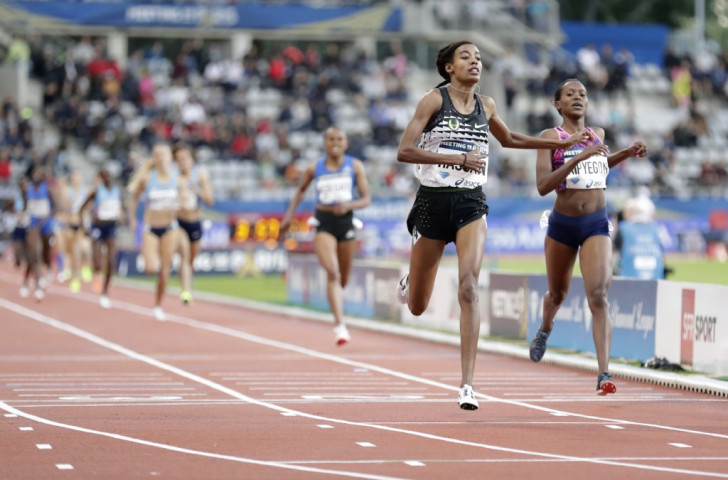 Sifan Hassan of the Netherlands holds on to defeat Kenya's Olympic champion Faith Kipyegon over 1500m at the IAAF Diamond League meeting in Paris ©Getty Images