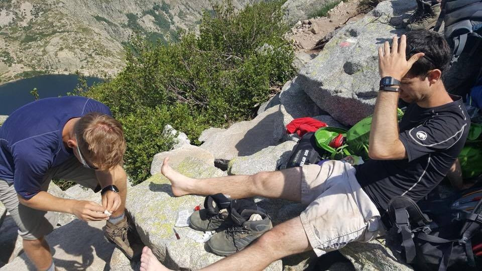 My friend had the unfortunate job of helping treat my blisters on the side of a mountain ©Daniel Woodgate