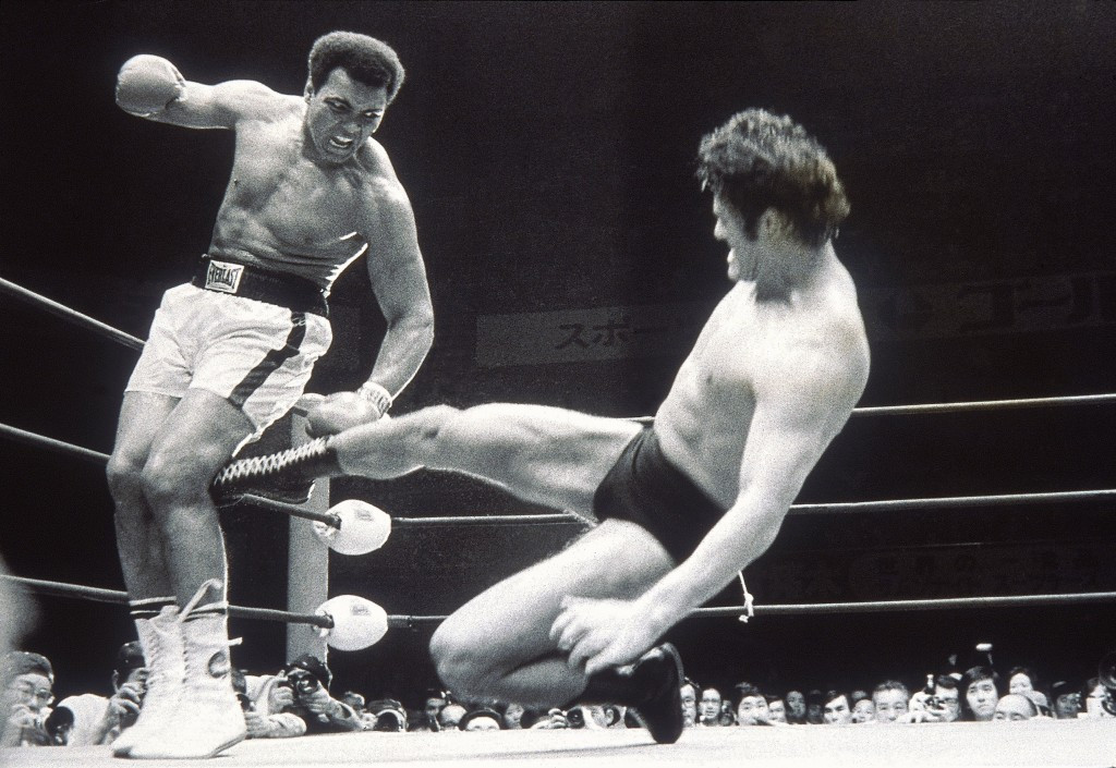 Antonio Inoki sends another kick to Muhammad Ali's leg during their infamous
