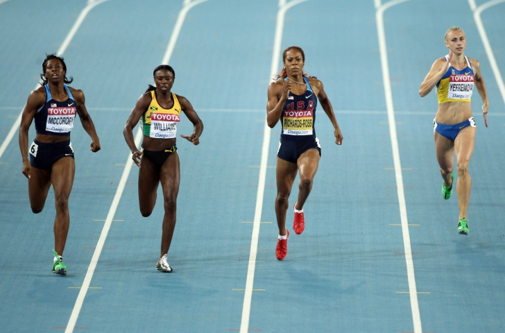 Shericka Williams, pictured second left in action during the 400m semi-finals at the 2011 IAAF World Championships, is  one of three Jamaicans seeking to run for Bahrain next year ©Getty Images