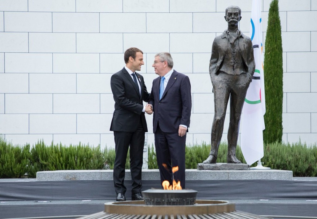 Macron meets Bach in rain at Olympic Museum