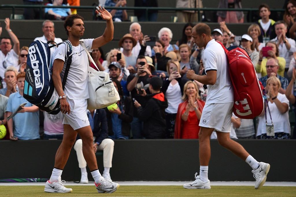 Muller stuns Nadal in marathon Wimbledon classic