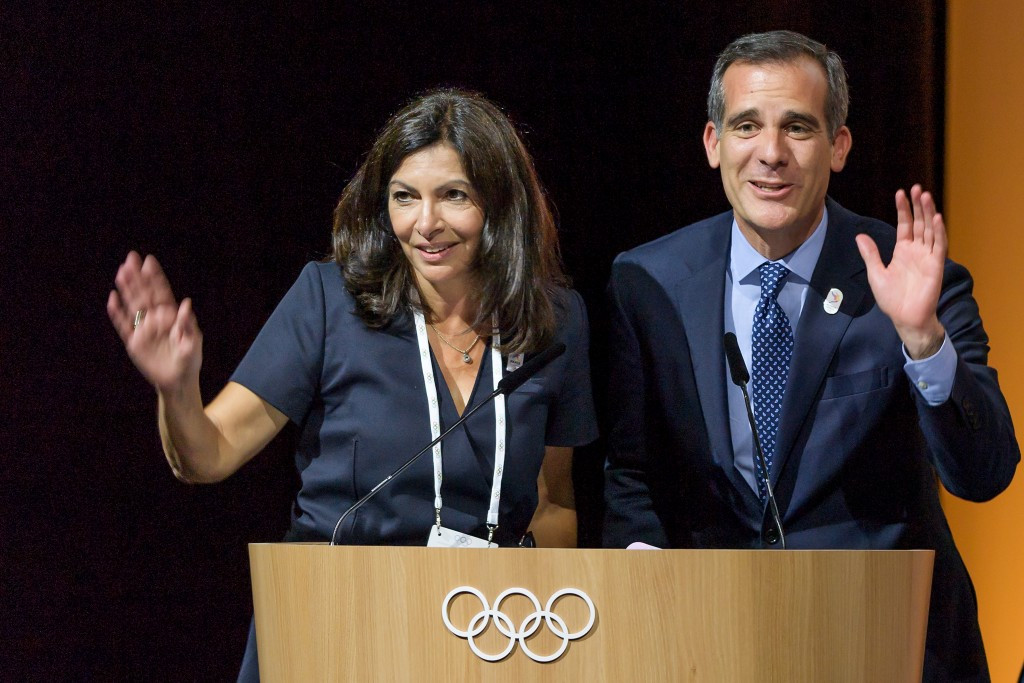 Anne Hidalgo, left, and Eric Garcetti collectively thank the IOC for their joint-awarding approval ©Getty Images