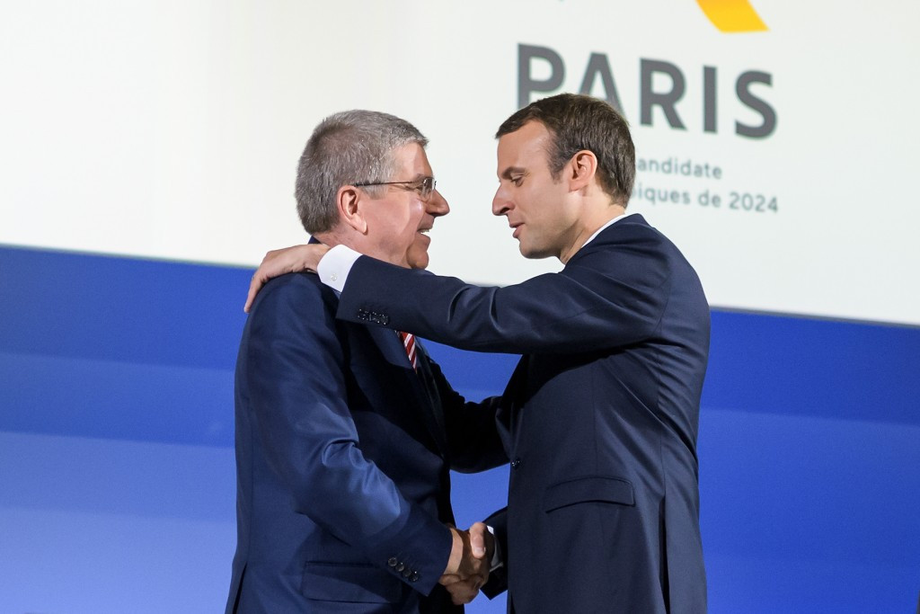 French President Emmanuel Macron, right, embraces IOC counterpart Thomas Bach ©Getty Images