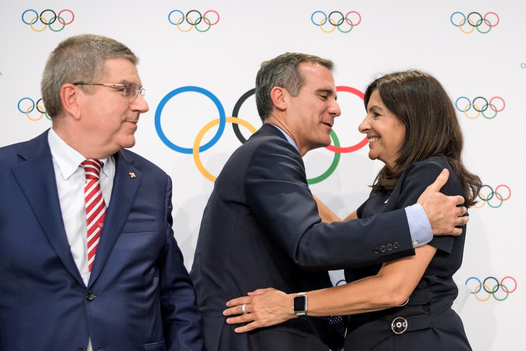 Informal talks have already taken place between Thomas Bach, left, Eric Garcetti, centre, and Anne Hidalgo ©Getty Images