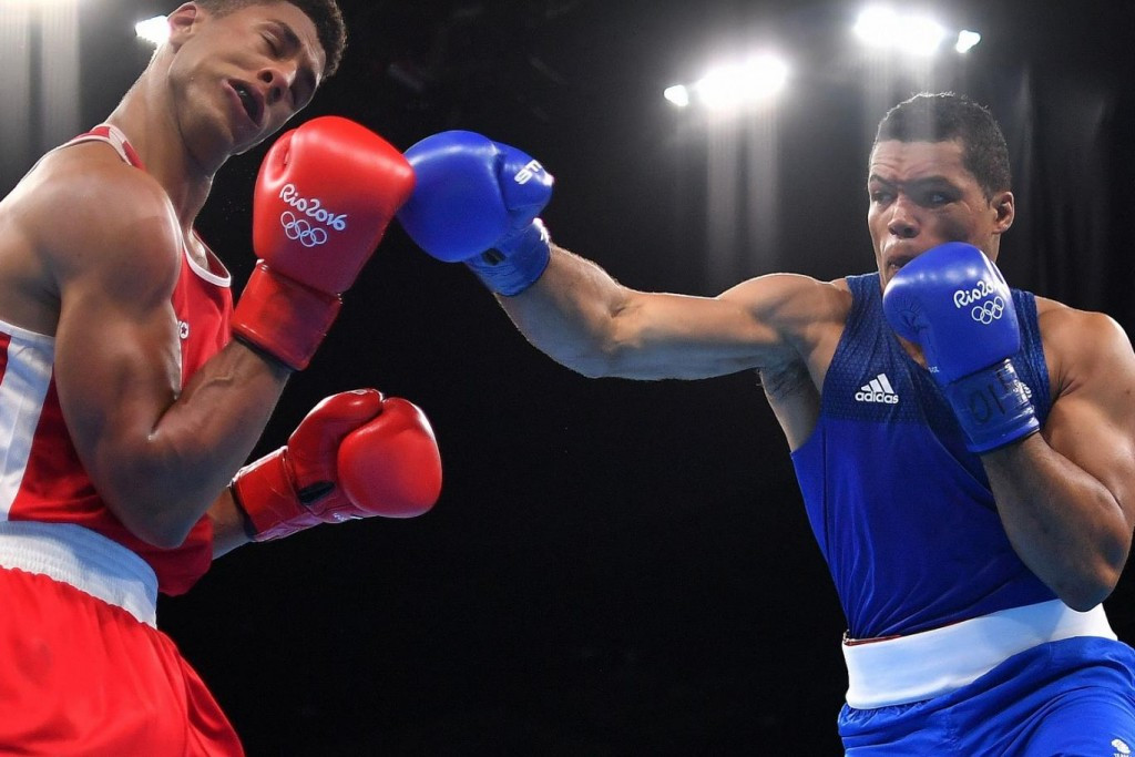 Joe Joyce, in blue, is one of two British Olympic boxers to have signed a deal with the promotional outfit partly headed by former world heavyweight champion David Haye ©Getty Images