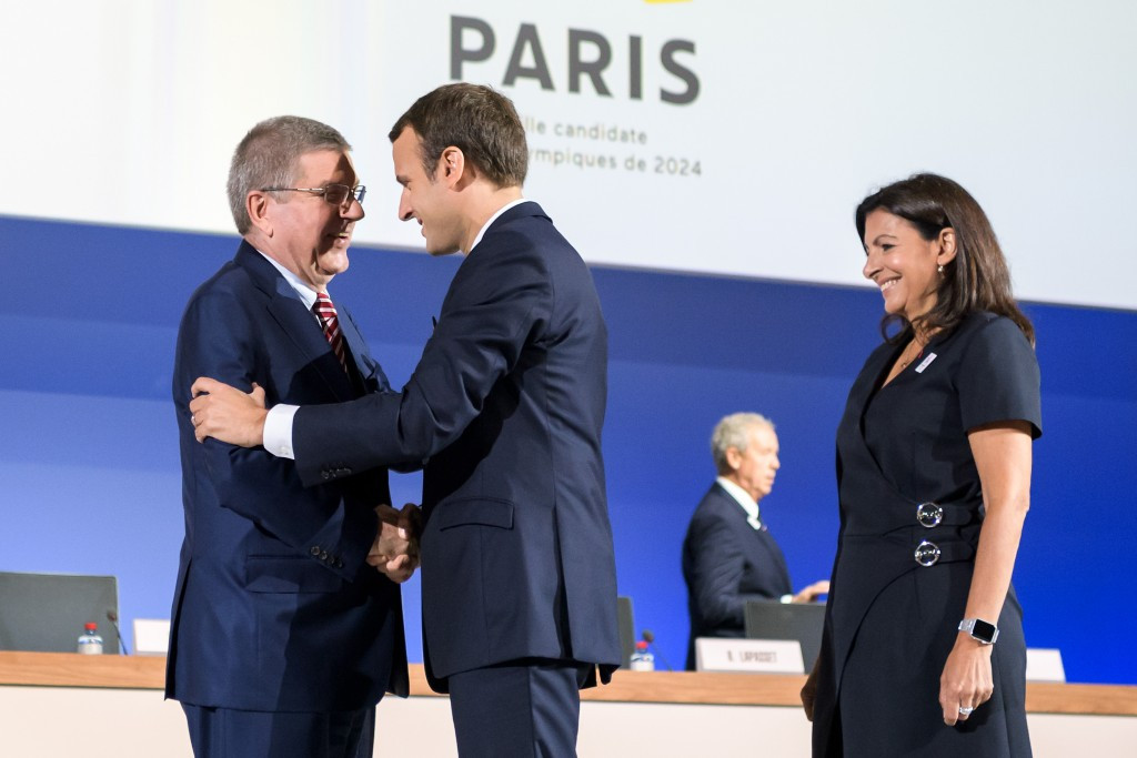 Thomas Bach, left, with French President Emmanuel Macron, showed all his political skill during the discussions about the joint awarding of the 2024 and 2028 Olympic and Paralympic Games ©Getty Images
