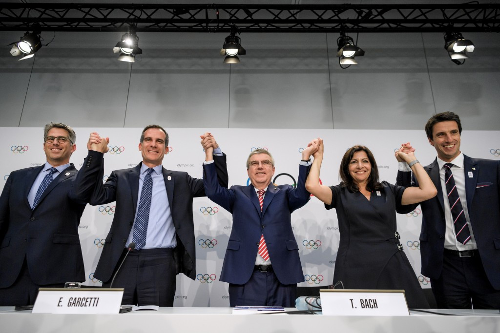 Thomas Bach, centre, cut a delighted figure as he hailed a