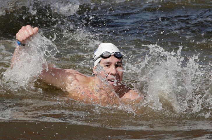South Africa's Chad Ho celebrates winning the men's five kilometres race