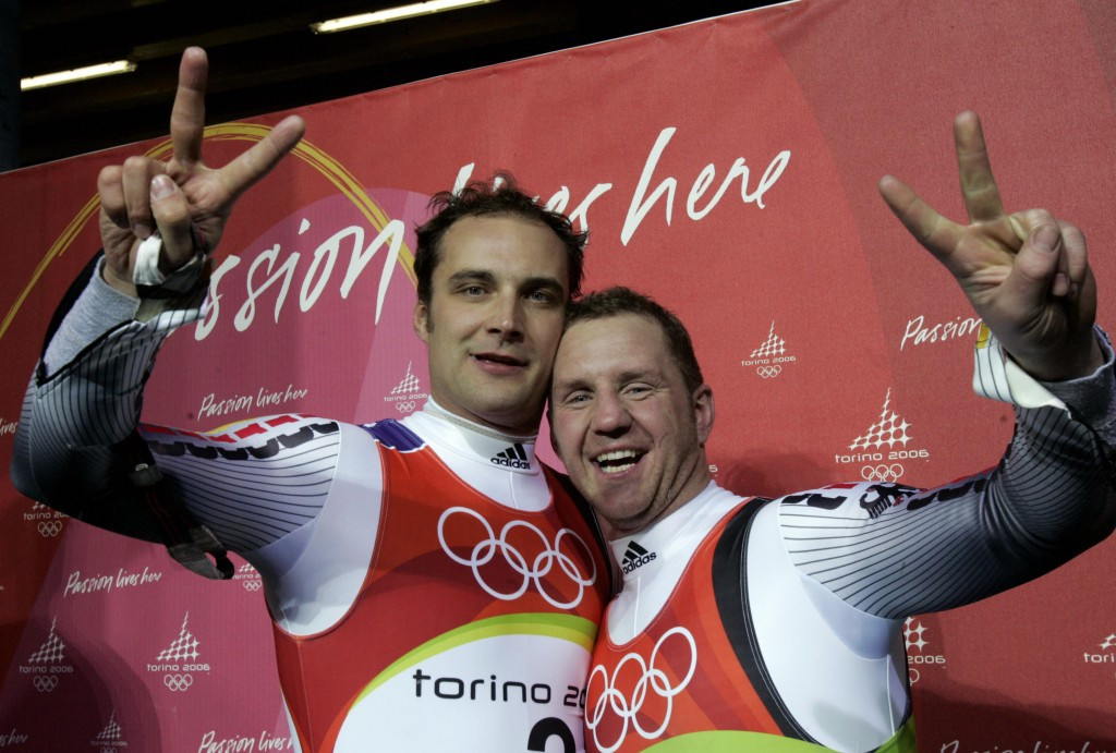 Andre Florschuetz, left, celebrating silver at Turin 2006 alongside Torsten Wustlich ©Getty Images