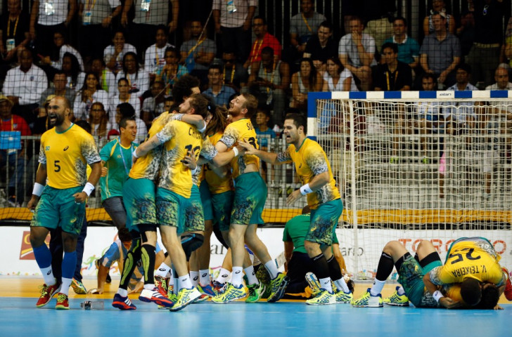 Brazil win overtime thriller in handball on night of relay drama at Toronto 2015