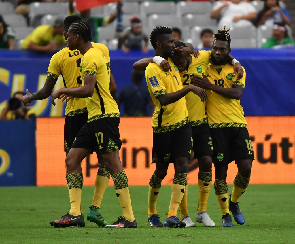 Jamaican players celebrate Romario Williams' winner in their 2-1 victory against Canada ©Getty Images