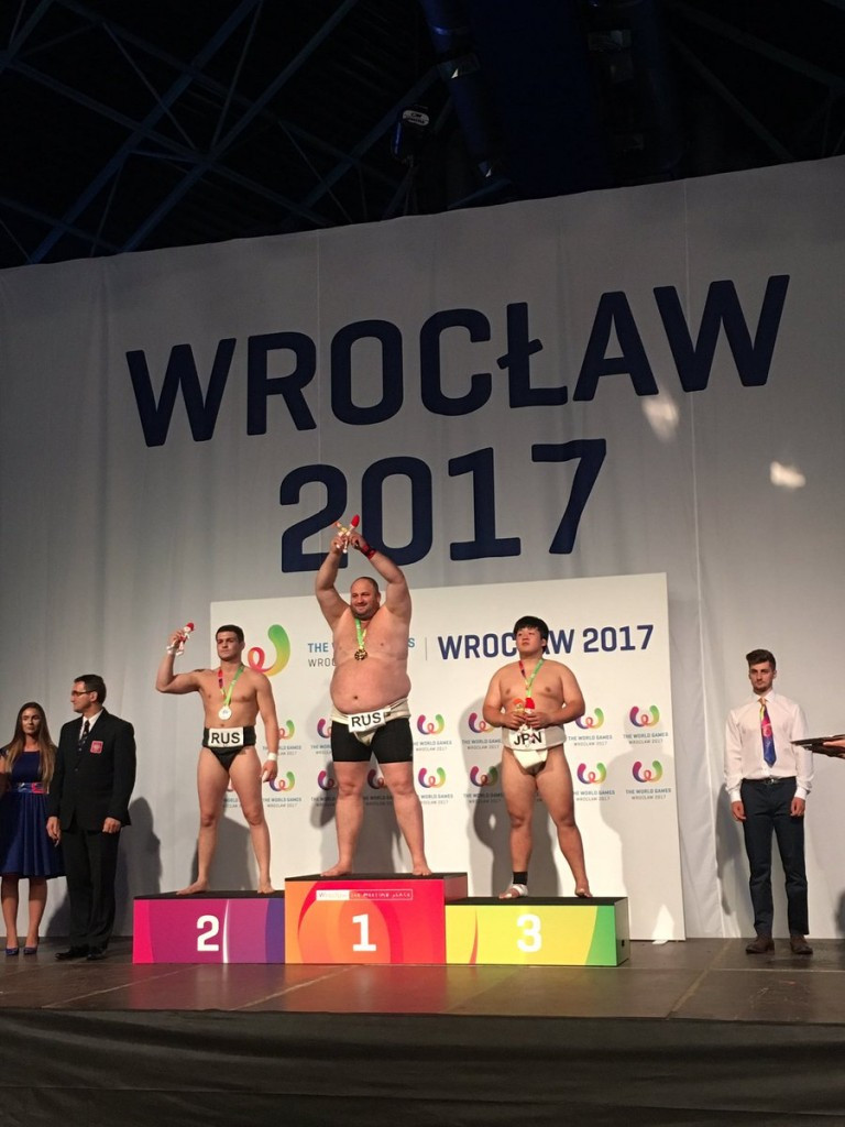 Russia's Vasilii Margiev, centre, claimed the open weight sumo wrestling gold today ©IWGA