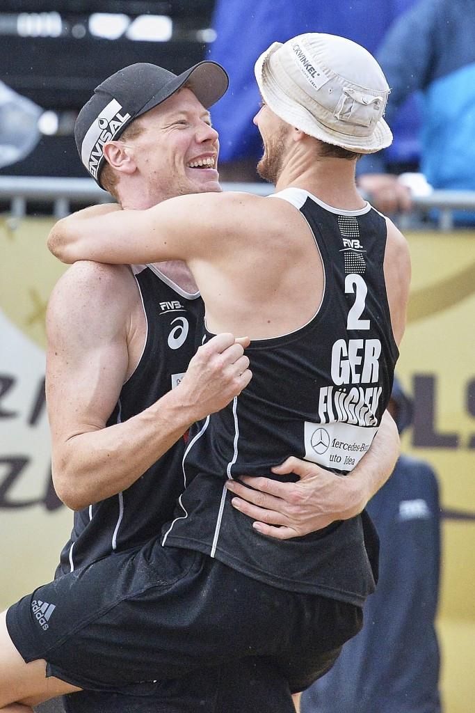 Germany's Markus Böckermann and Lars Flüggen celebrate winning the men's title ©Getty Images