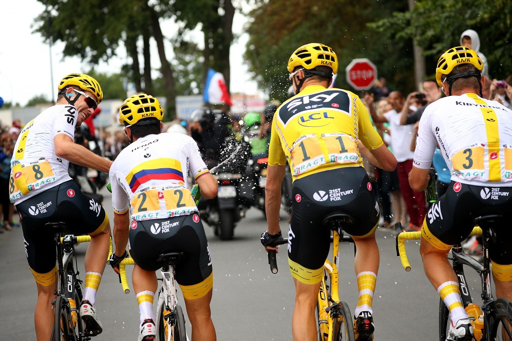 Chris Froome joins his team-mates for an impromptu celebration while still on the stage ©Getty Images