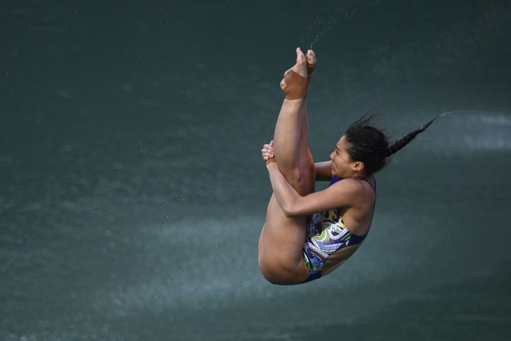 London 2012 champion He retires from diving