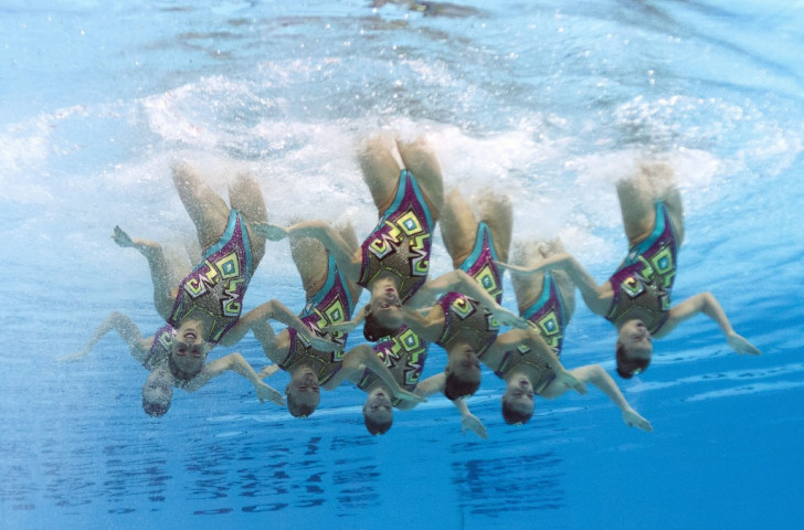 Russia maintained their strong form in synchronised swimming with team technical success