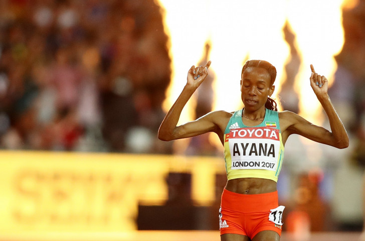 Ethiopia's Almaz Ayana salutes a huge win in the world 10,000m final in London ©Getty Images
