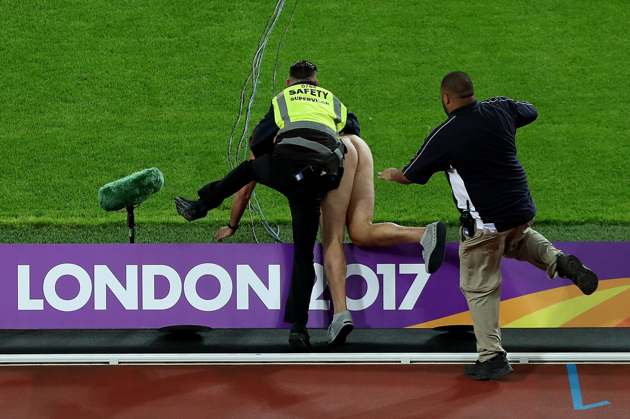 The streaker initially sidestepped lumbering security before being tackled and restrained ©Getty Images