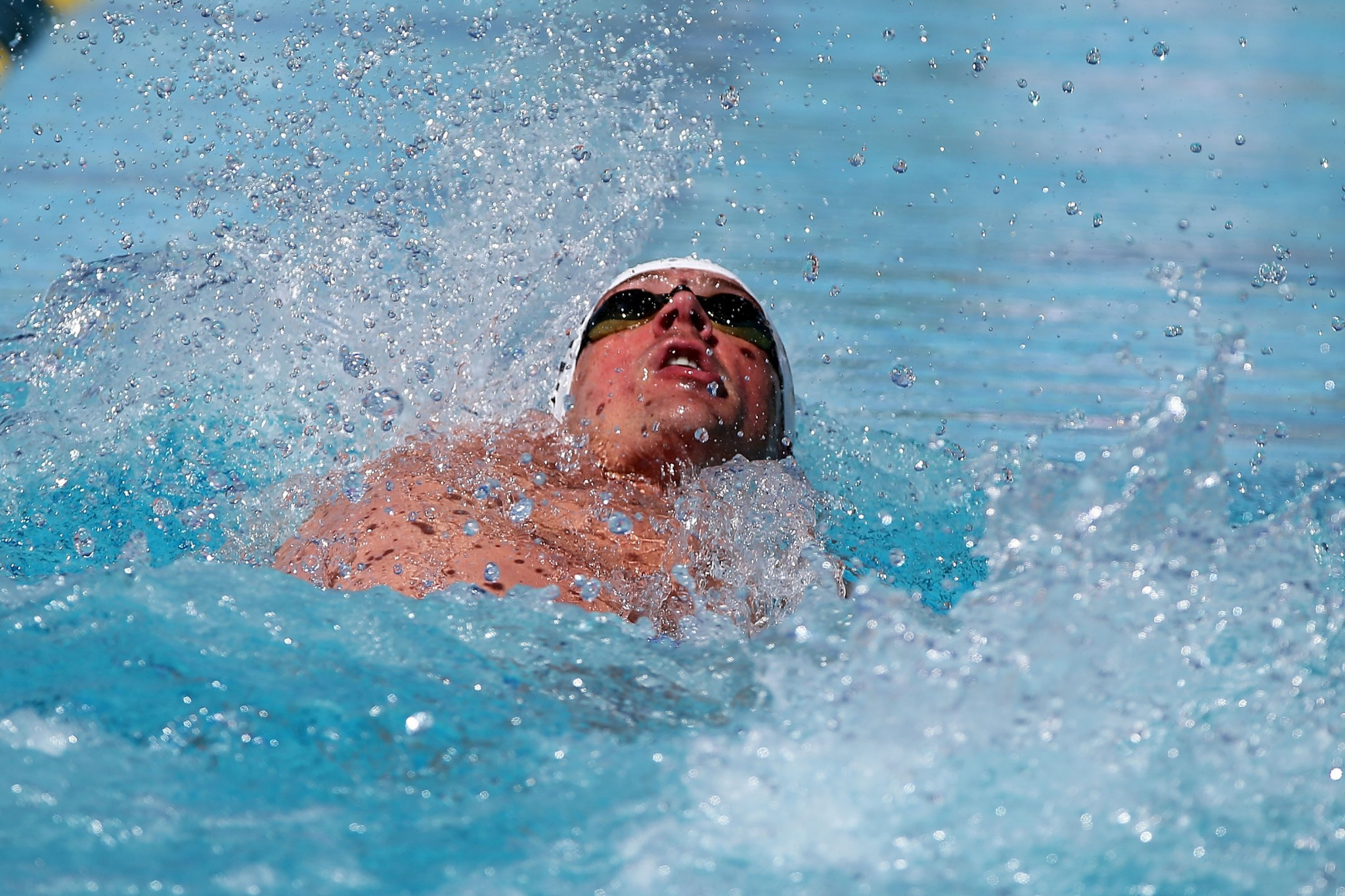Lochte finishes fifth on return to competitive swimming