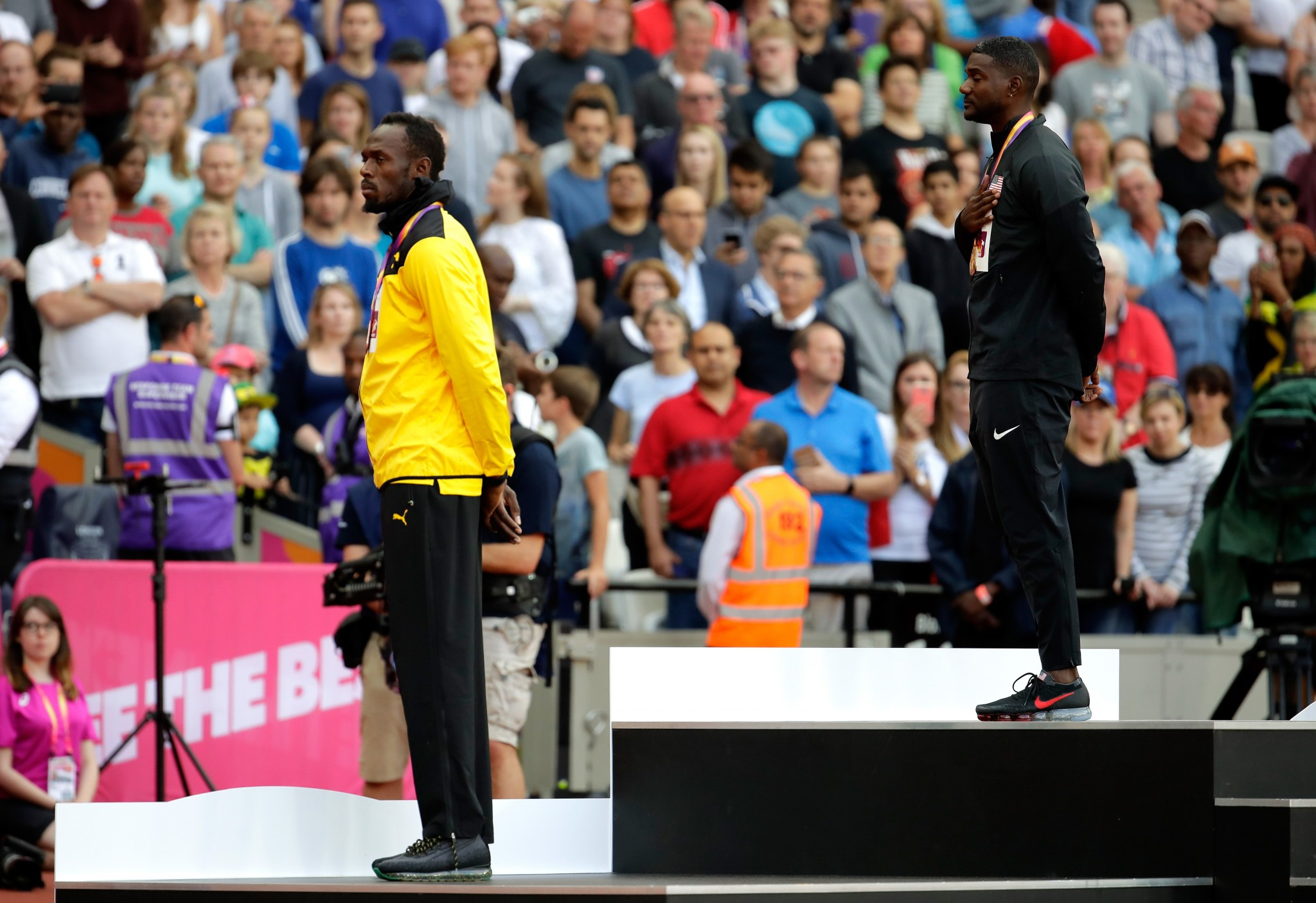 Justin Gatlin, centre, was booed when he was presented with his gold medal for victory in the 100 metres at the IAAF World Championships, with Usain Bolt, right, getting the bronze ©Getty Images