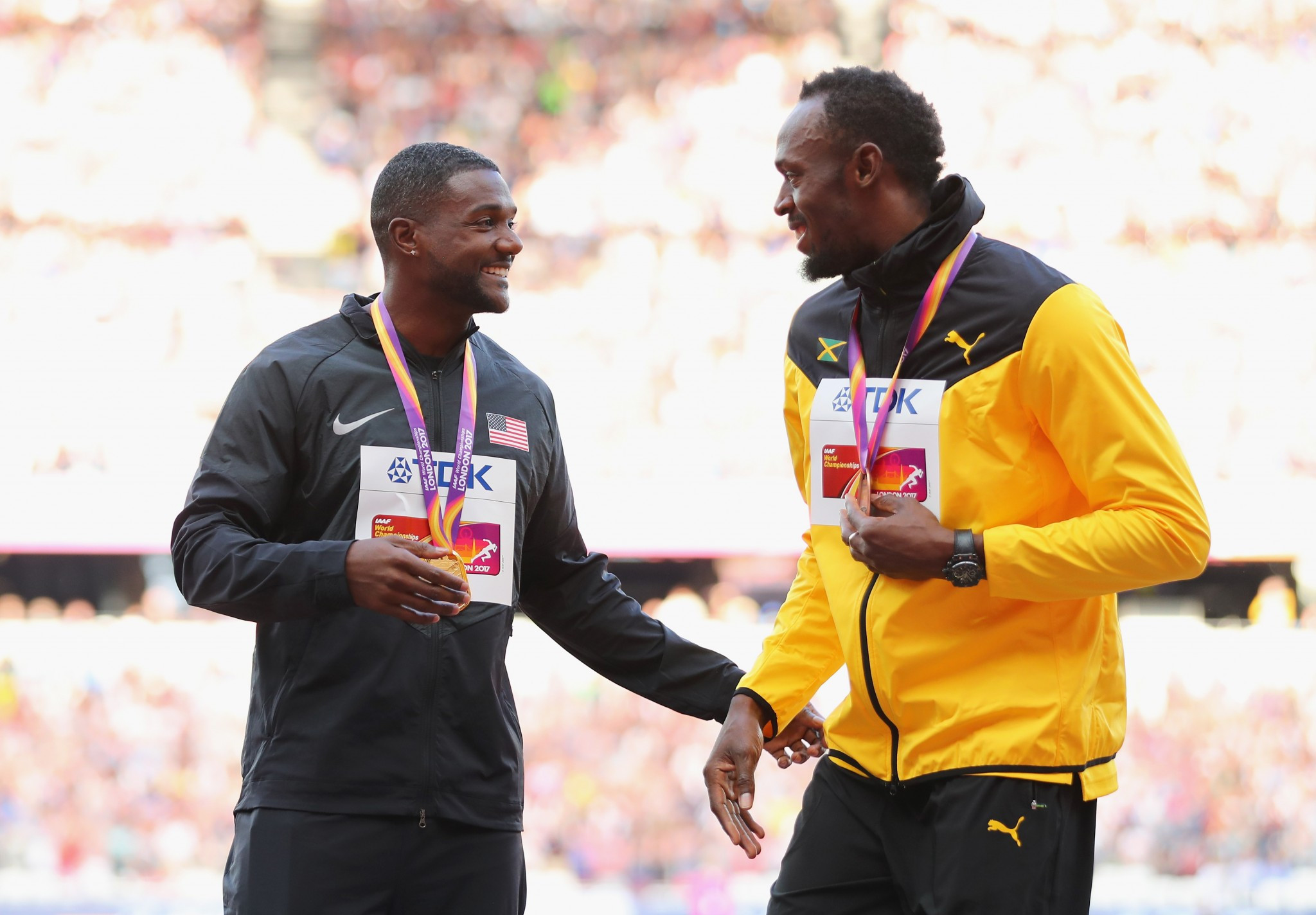 Justin Gatlin, left, gained a shock win over Christian Coleman and Usain Bolt, right ©Getty Images