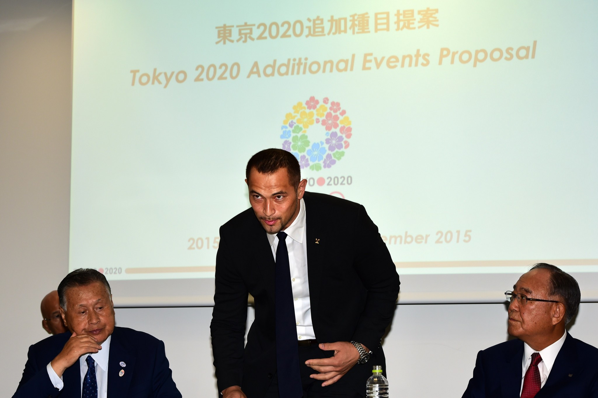 Koji Murofushi, centre, believes ensuring participation from the world's best players should be the priority ©WBSC