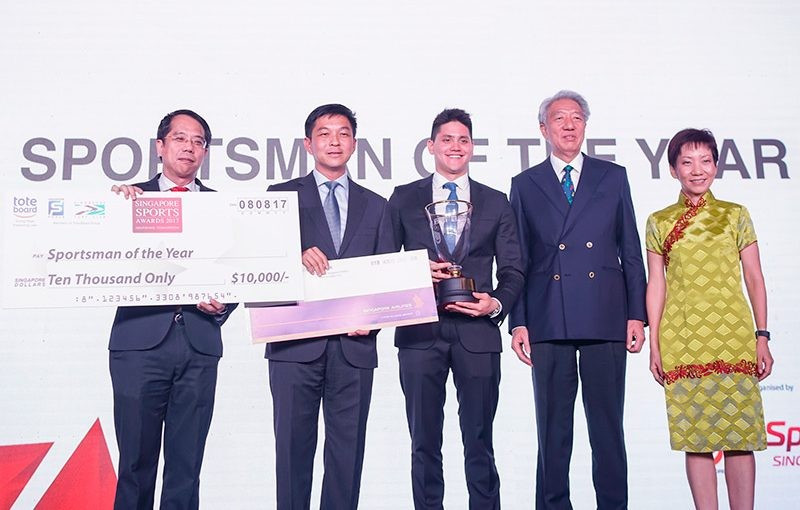 Swimmer Joseph Schooling and bowler New Hui Fen received the respective sportsman and sportswoman of the year prizes at the 2017 Singapore Sports Awards ©SNOC