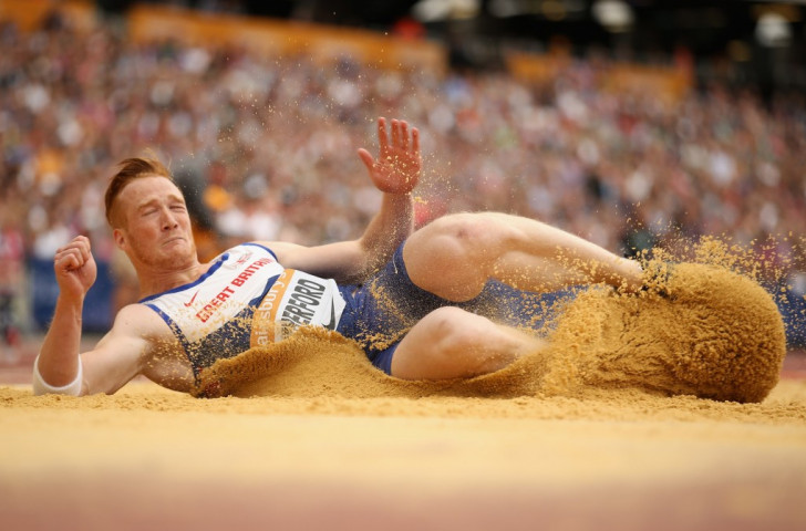 Britain's Olympic long jump champion Greg Rutherford lands in the sand during last weekend's Sainsbury's Anniversary Games in the Olympic Stadium. Soon he will have his own backyard sandpit sorted out and certified ©Getty Images