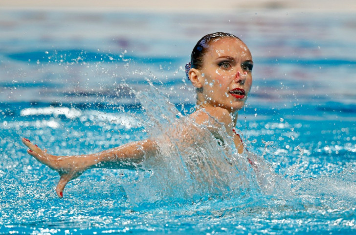 Russia's Natalia Ishchenko now has 18 world titles to her name after success in the synchronised swimming solo free event