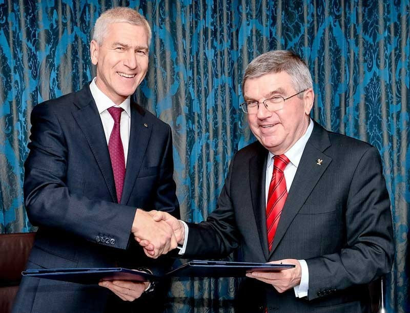 Oleg Matytsin, left, President of the International University Sports Federation, meets IOC President Thomas Bach at last month's World Games to discuss ongoing co-operation between their organisations ©FISU