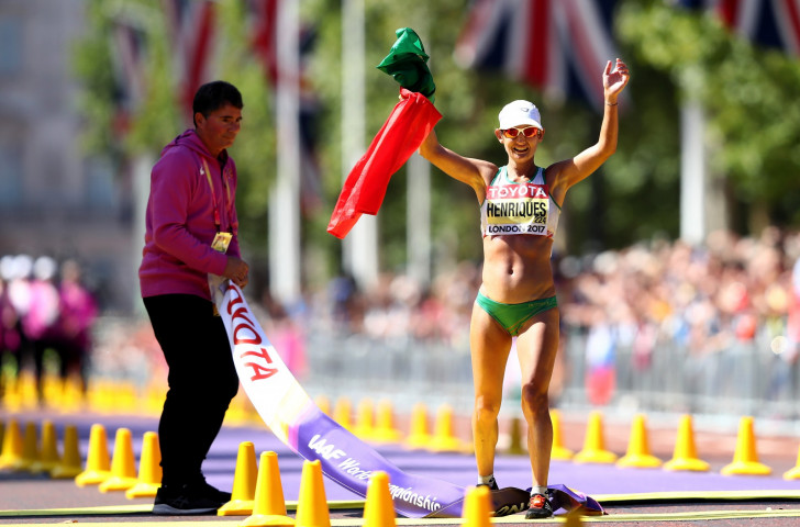 Portugal's Ines Henriques crosses the line in The Mall to win the first women's 50km race walk final at an IAAF World Championships, breaking her own world record in so doing ©Getty Images