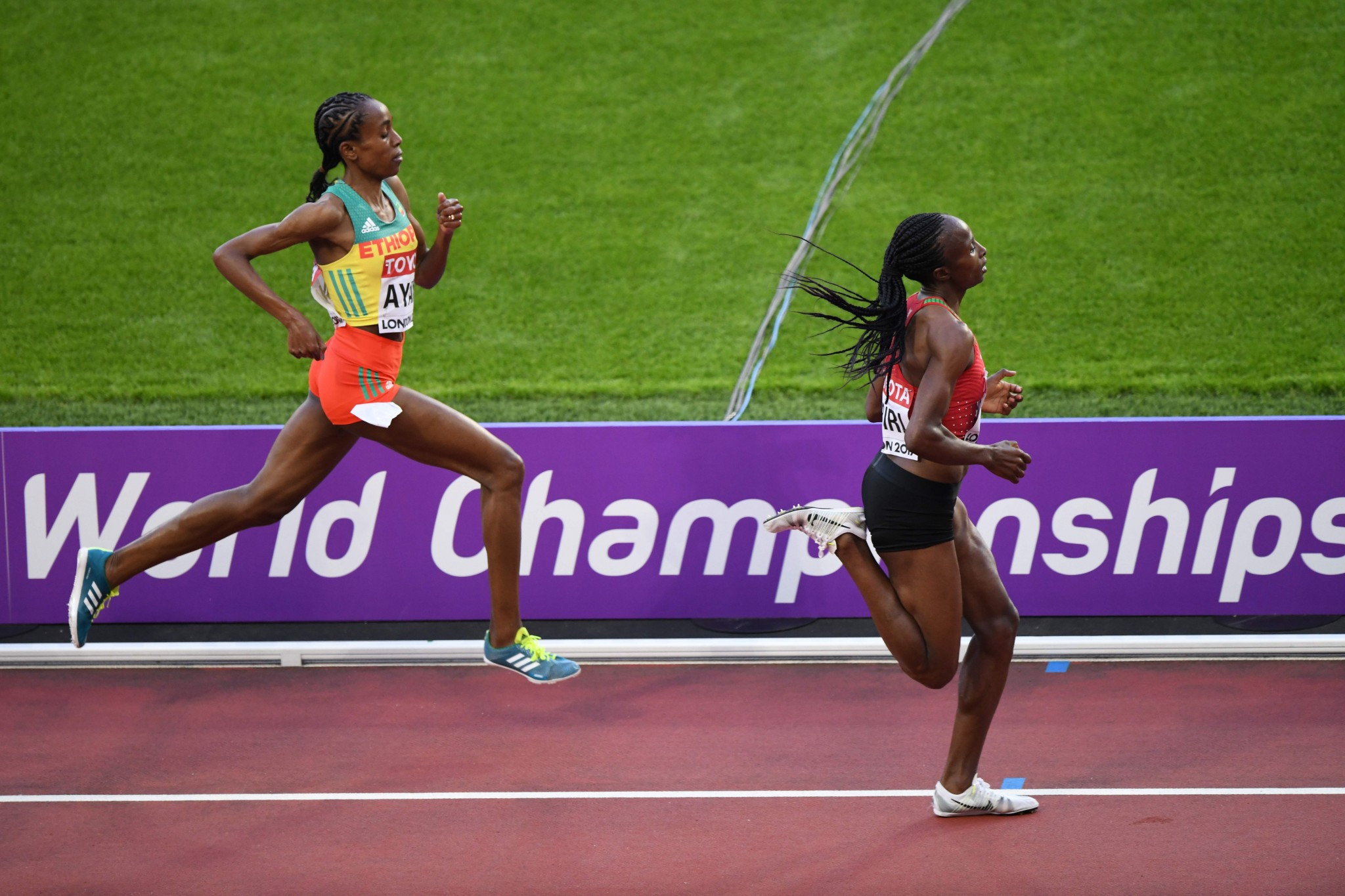 Hellen Obiri of Kenya outsprinted Almaz Ayana of Ethiopia to take gold in the women's 5,000m ©Getty Images