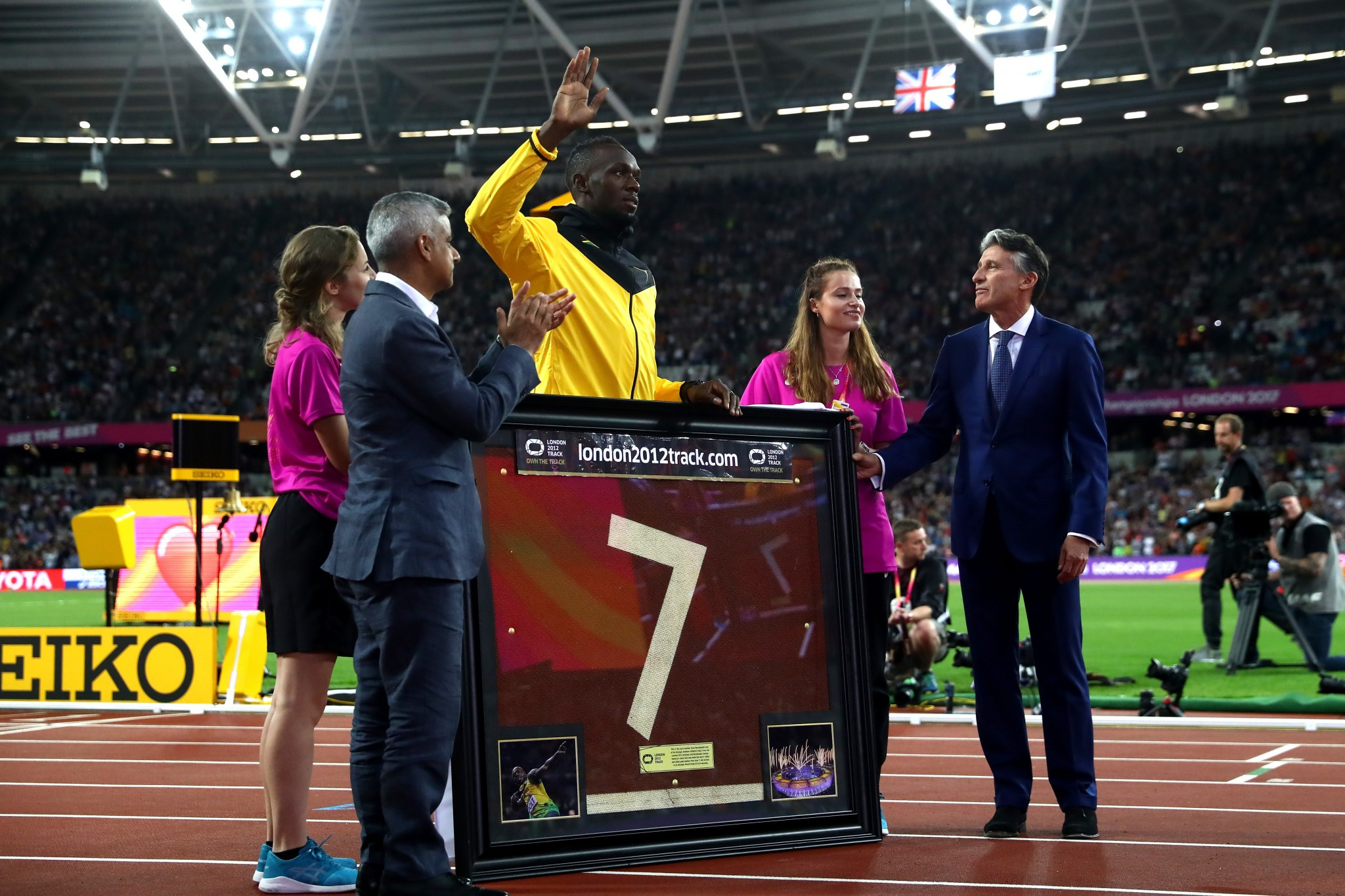Usain Bolt was presented with a portion of the London 2012 track during his lap of honour ©Getty Images