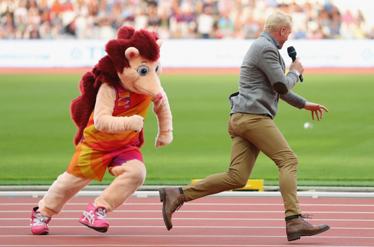 Hero makes one of his habitual violent moves during the IAAF World Championships in London on infield MC Iwan Thomas, playing Cato to the former athlete's Inspector Clouseau....©Getty Images