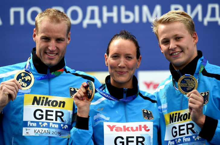 Christian Reichert (left), Isabelle Harle (centre) and Rob Muffels (right) won gold for Germany in the five kilometres mixed team swimming event