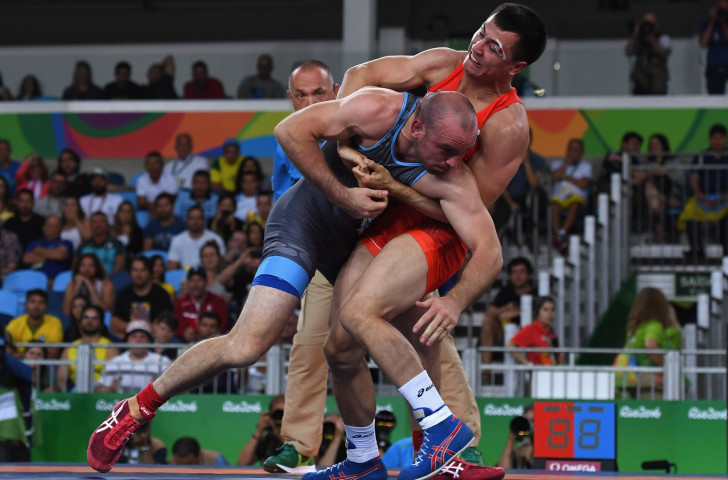 Russia's Roman Vlasov, right, will seek a world title at 80kg in Paris this coming week ©Getty Images