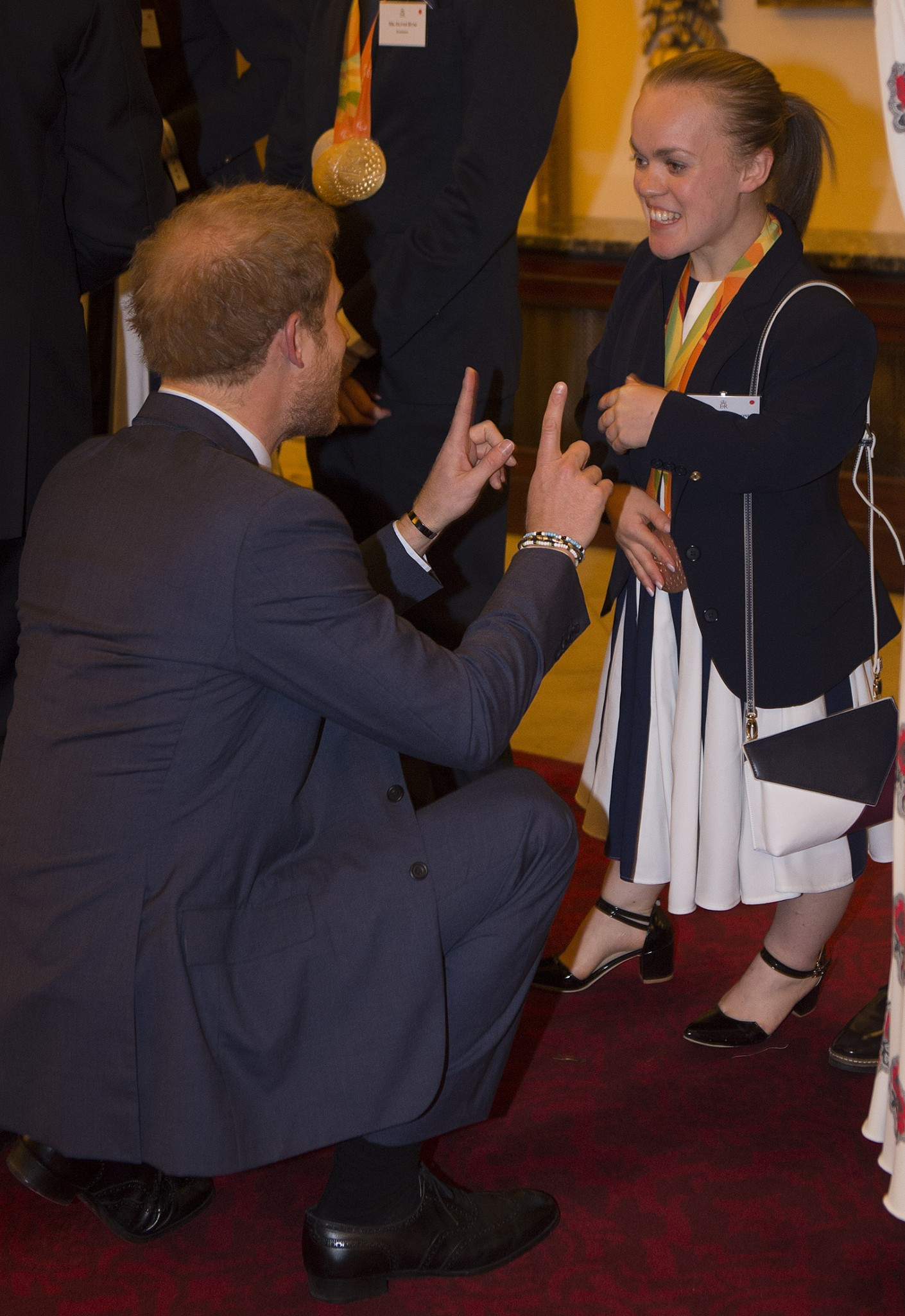 Ellie Simmonds chats with Prince Harry at a Buckingham Palace reception for Britain's Olympic and Paralympic teams from the Rio Games ©Getty Images