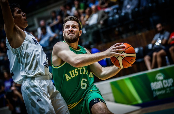 Mitchell Norton of Australia resists a New Zealand challenge during his side's 106-79 win in the FIBA Asia Cup semi-final in Lebanon ©FIBA