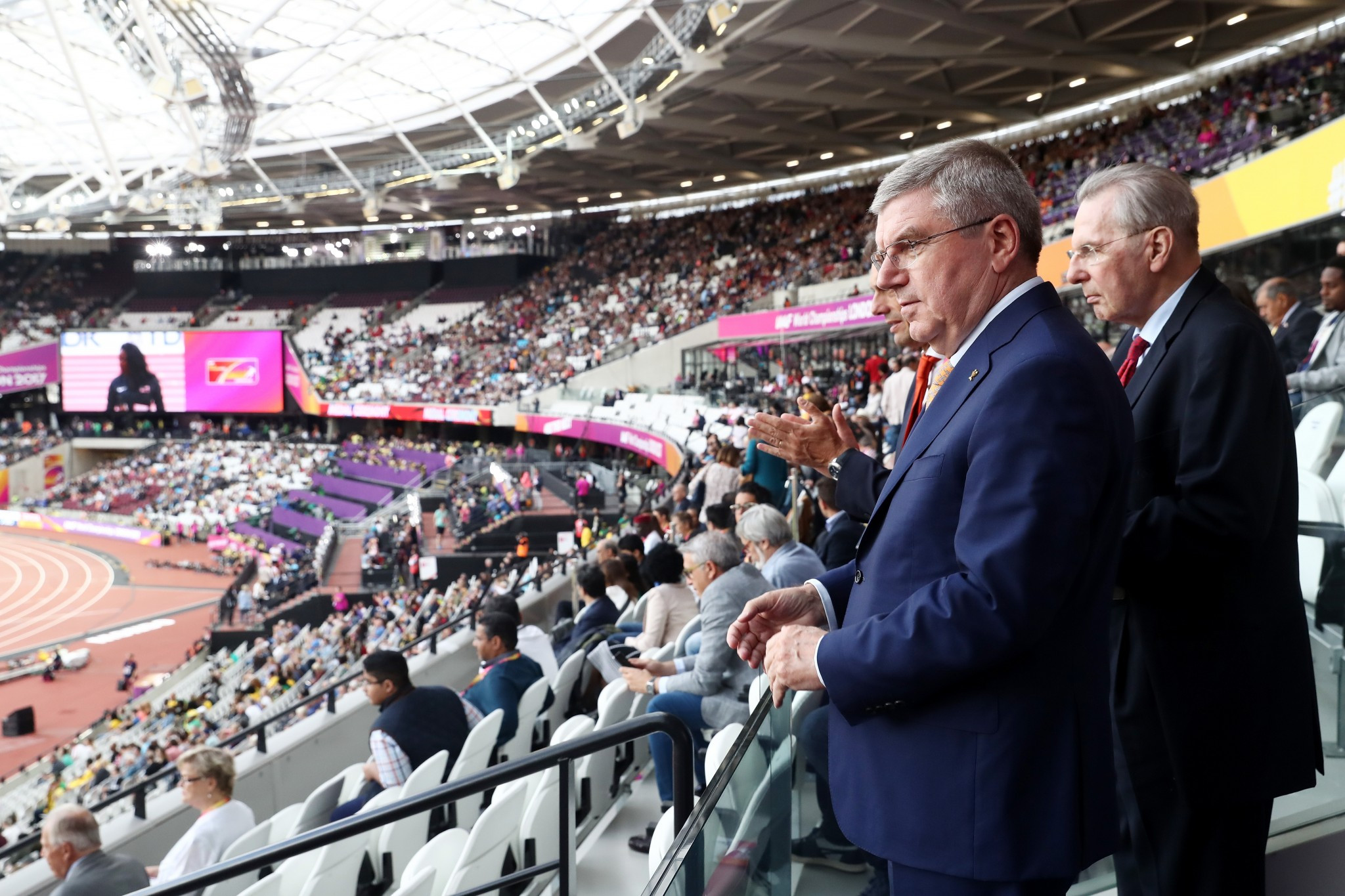 Past and present IOC Presidents Jacques Rogge, right, and Thomas Bach, watch the World Athletics Championships in London ©Getty Images